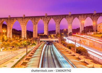 "View of the historic aqueduct in the city of Lisbon (Aqueduto das Águas Livres), Portugal. Train station ""Campolide"" at the evening"