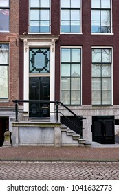 a view of a historic brownstone in an iconic neighborhood of Amsterdam