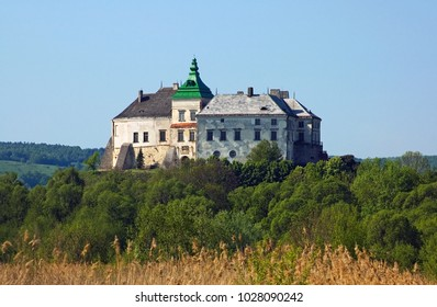 View to the historic castle under the blue sky in Olesko, Lviv region in Ukraine. Horizontal outdoors shot.