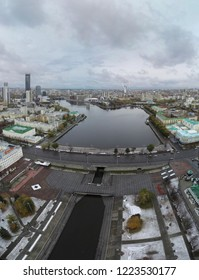 """View of the historic center, the city pond, and the business district """"Ekaterinburg-city"""" Ekaterinburg. Russia - 15 October 2018"""