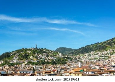 View of the historic center of Quito, Ecuador with rolling hills in the background