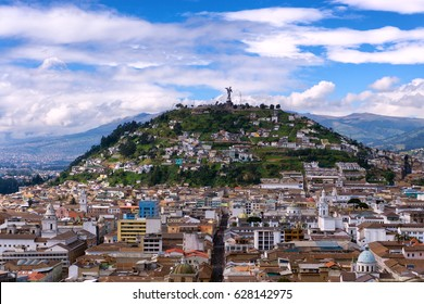 View of the historic center of Quito, Ecuador as with Panecillo hill rising in the background