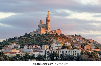 "View of the historic church ""Notre Dame de la Garde"" of Marseille in South France during sunset"