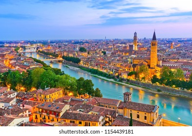 View of the historic city center along Adige river at dusk in Verona, Italy.