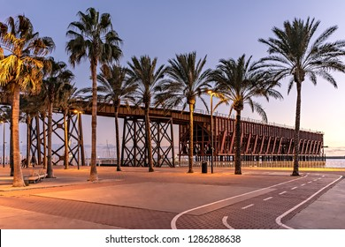 View of historic English cable or pier in Almeria, Spain, at dusk.