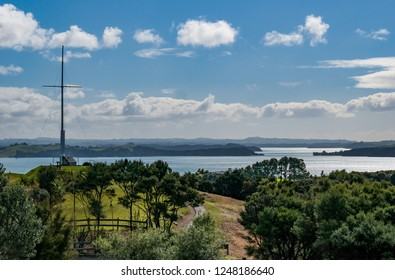View of the historic Flag Pole in Russell with Waitangi in the background