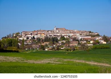 """View of historic Monflanquin, Lot-et-Garonne, France. The hilltop bastide town is a member of """"Les Plus Beaux Villages de France"""" association."""