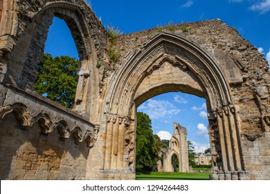 A view of the historic ruins of Glastonbury Abbey in Somerset, UK.