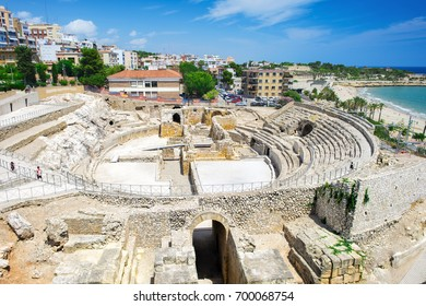 View to the historic site of an ancient Roman amphitheater near the Mediterranean coast in Tarragona, Spain
