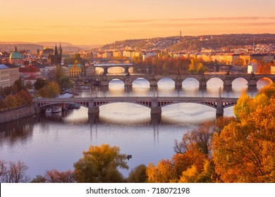 View to the historical bridges, Prague old town and Vltava river from popular view point in the Letna park (Letenske sady), beautiful autumn landscape in soft yellow morning light, Czech Republic