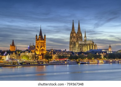 View of historical center of Cologne from Rhine river in evening, Germany