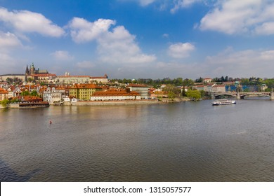 View of historical center of Prague, buildings and landmarks of old town. Boat cruise on Vltava river. Czech Republic. Top tourist attraction in Europe. Concept of travel, sightseeing and tourism.