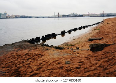 View of the historical city center of Saint-Petersburg, Russia, and its landmarks: the Neva river, Arrow of the Basils Island. View from the beach in Peter and Paul fortress. Popular landmarks.