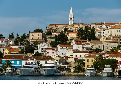 View of the historical part of the city in the center of Vrsar, Croatia. Above the houses with tiled rises Tower.