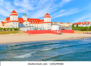 View of historical spa building and sandy beach from pier in Binz summer resort, Ruegen island, Baltic Sea, Germany