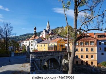View of the historical town of Murau. Stone bridge over Mur river. Murau, Styria, Austria.