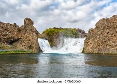 View of Hjalparfoss waterfall of Iceland.