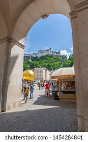 View of Hohensalzburg Castle from archway in Kapitelplatz, Salzburg, Austria, Europe 1-6-2019