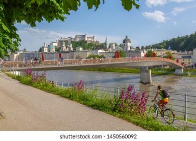 View of Hohensalzburg Castle and footbridge over Salzach River, UNESCO World Heritage Site, Salzburg, Austria, Europe 1-5-2019
