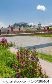 View of Hohensalzburg Castle and footbridge over Salzach River, UNESCO World Heritage Site, Salzburg, Austria, Europe 1-6-2019