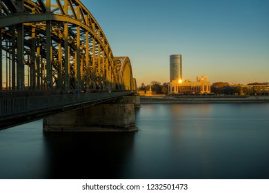 View of the Hohenzollern Bridge, the Hyatt Regency, the Cologne Triangle and the Big River Rhine at Sunset in Germany Cologne 2018.