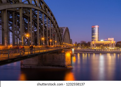 View of the Hohenzollern Bridge, the illuminated Skyscraper Cologne Triangle, the Hyatt Regency and the Long River Rhine (one of the longest Rivers in Europe) at Night in Germany Cologne in 2018.