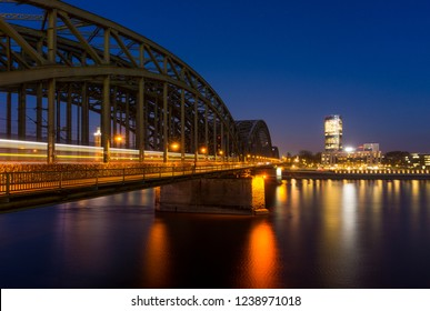 View of the Hohenzollernbridge, the Cologne Triangle, the Hyatt Regency and  the River Rhine at Night in Germany Cologne 2018.