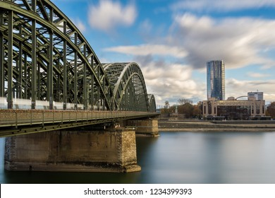 View of the Hohenzollernbridge, the Skyscraper Cologne Triangle, the Hyatt Regency and the Long River Rhine (one of the longest Rivers in Europe) on a cloudy day in Germany Cologne in 2018.