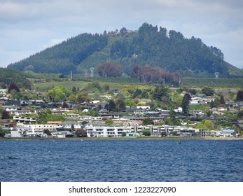 View of holiday homes and accommodation buildings along shores of beautiful Lake Taupo New Zealand