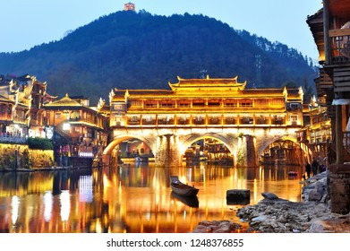 View of Hong bridge during twilight over the Tuojiang River (Tuo Jiang River) in Fenghuang old city (Phoenix Ancient Town),Hunan Province, China.