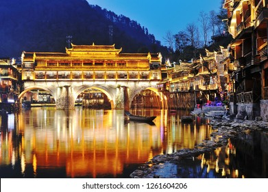 View of Hong bridge (Rainbow bridge) during twilight over the Tuojiang River (Tuo Jiang River) in Fenghuang old city (Phoenix Ancient Town),Hunan Province, China.