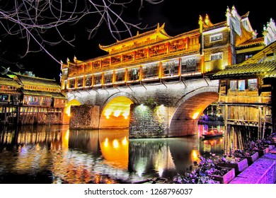 View of Hong bridge (Rainbow bridge) at night over the Tuojiang River (Tuo Jiang River) in Fenghuang old city (Phoenix Ancient Town),Hunan Province, China.