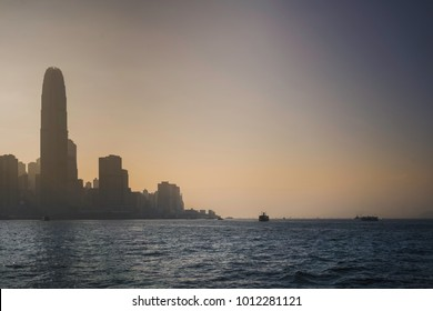 View of Hong Kong island and sea at Sunset. Seen from the ferry leaving Kowloon Harbour