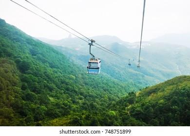 View of Hongkong mountain from cable car across to Tian Tan Buddha in Nongping village in Hong Kong, China