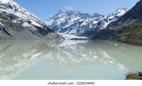 View of Hooker lake with the highest peak of New Zealand (Mt. Cook) in background