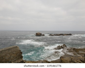 View of the horizon sea with rocks and waves