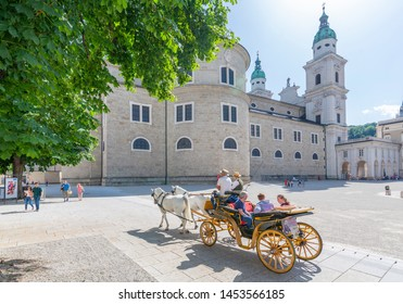 View of horse and carriage and Salzburg Cathedral in Residenzplatz, Salzburg, Austria, Europe 1-6-2019