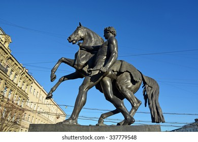 View of Horse tamers monument by Peter Klodt on Anichkov Bridge in Saint-Petersburg Russia. Popular touristic landmark