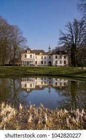 View of the house in Baak reflecting in the canal near the village of the same name in the Dutch region Achterhoek
