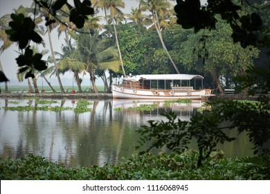 View of House Boat resting on Vembanad Lake from Kumarakom Bird Sanctuary - Kottayam, Kerala.