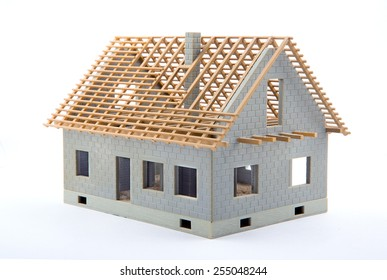 View of a House miniature under construction on an architect desk
