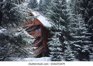 View of the house in the snowy mountains in winter.