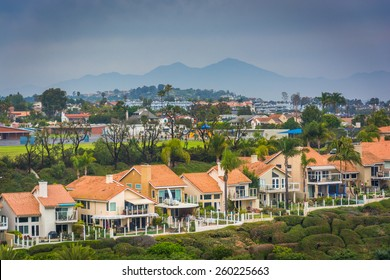 View of houses and distant mountains from Hilltop Park in Dana Point, California.