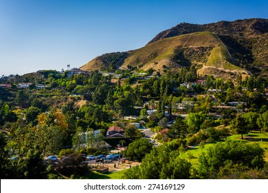 View of houses and hills in Hollywood from Canyon Lake Drive in Los Angeles, California.