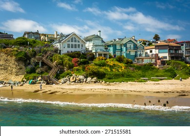 View of houses on bluffs above the beach, in Capitola, California.