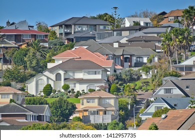 View of houses on Highland Park hill with colorful roofs