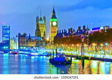 View of the Houses of Parliament along River Thames in London at night.