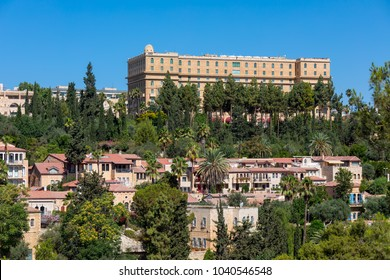 View of the houses of Yemin Moshe neighborhood under blue sky in Jerusalem, Israel.