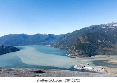 View of Howe Sound and Squamish shipping terminals from the summit of Stawamus Chief, Squamish, British Columbia, Canada