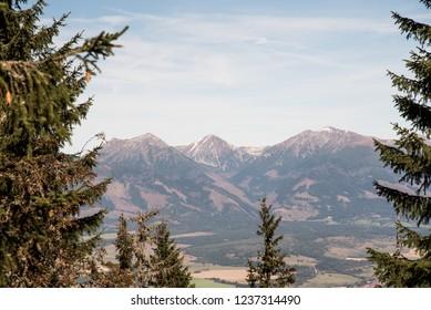 view to Hruby vrch, Jakubina, Klin, Nizna Bystra and Bystra peaks in Zapadne Tatry mountains from Slema hill in Nizke Tatry mountains in Slovakia during nice autumn day with blue sky